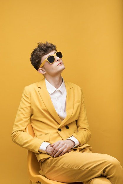 portrait-young-man-yellow-scene_23-2148184725